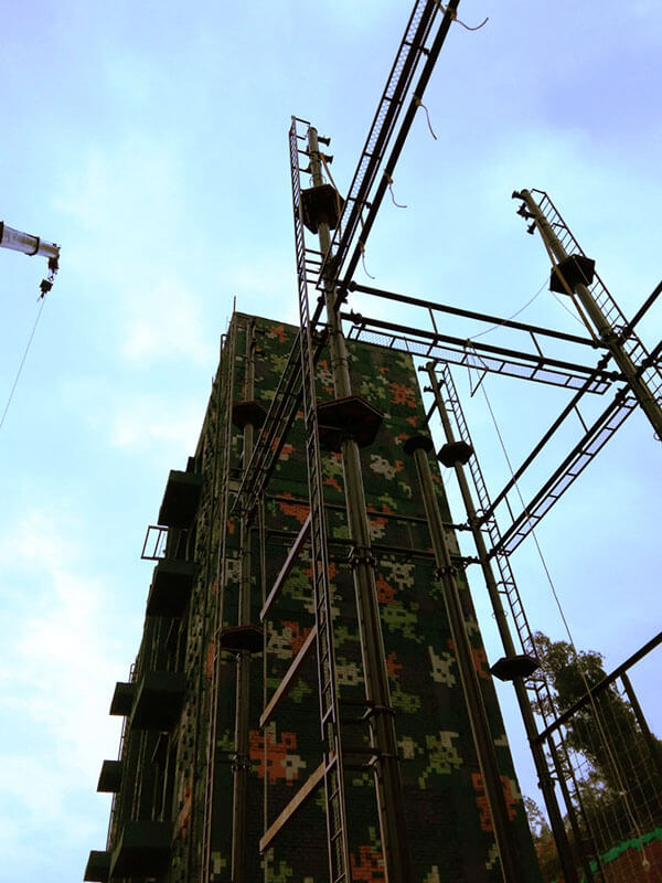 high ropes course, rock climbing wall, military training equipment
