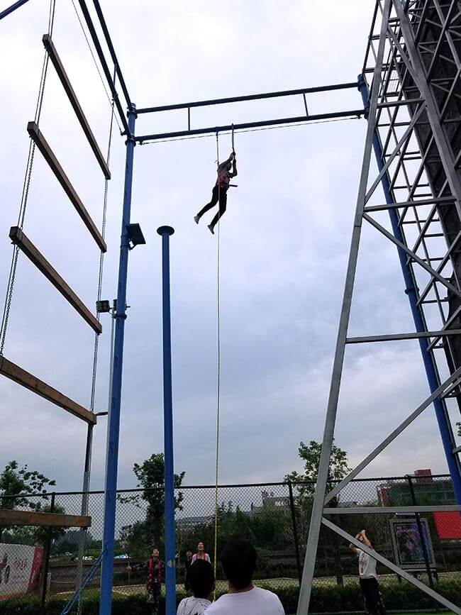 adventure playground, rock climbing wall, high ropes challenge, team building equipment