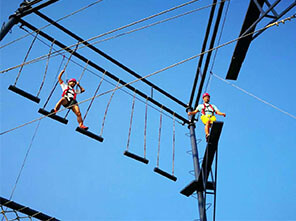 team building playground, high ropes challenge, rock climbing wall